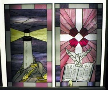 Window panels custom created for Faith Heritage Church.  Each piece of glass is hand cut, foiled, soldered and polished.