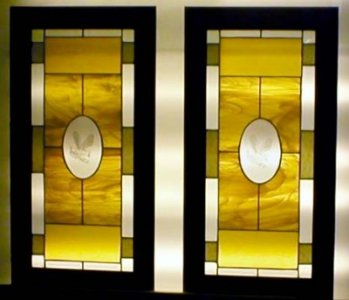 Hand made custom stained glass cabinet doors.  Each door features a center oval of an eagle eched into the glass.