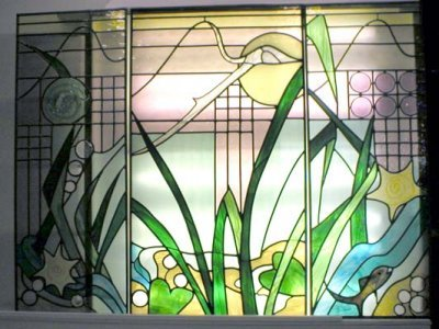 3 panels made for a bay window.  These pieces feature some fused glass pieces.  Each piece of glass was hand cut or kiln fused, then hand foiled and soldered.  Installation may be available upon request