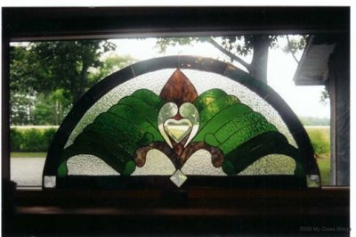 This is a photo of a custom one of kind piece of stained glass art.   If you would like to have a piece similar made for you please call Tina Montgomery at 989-358-WING (9464) or visit www.myglasswings.com